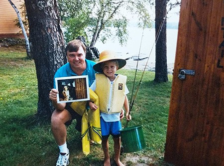 Father and son prepare for a day of fishing